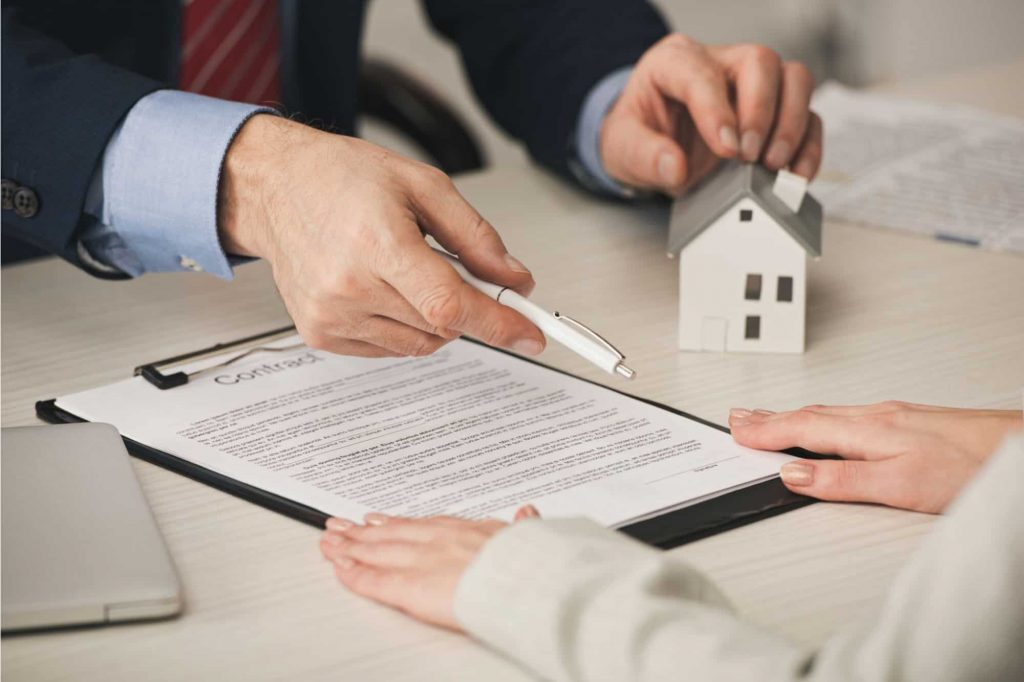 Signing a contract for a house sold